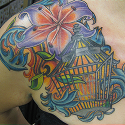 Tattoo of a bird cage