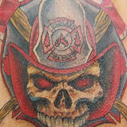 Tattoo of skull with firefighters helmet