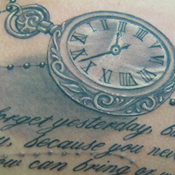 Tattoo of pocket watch with text