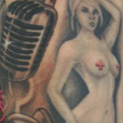 Tattoo of hourglass and microphone
