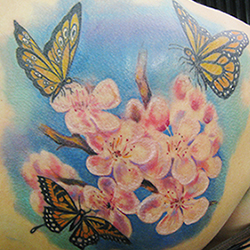 Tattoo of flowers and butterflys