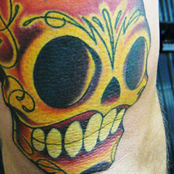 Tattoo of sugar skull with candle