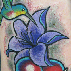 Tattoo of bird and flower